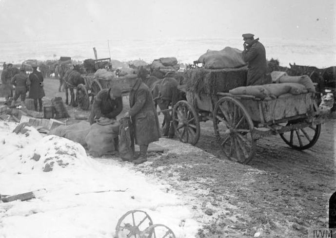 Horse transport of the Army Service Corps loading up at a Brigade dump for provisions. Albert, March 1917.